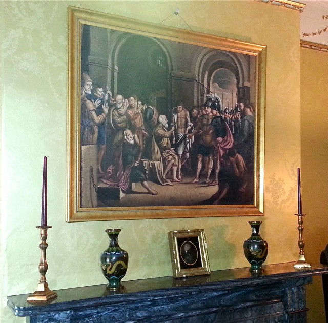 "A reproduction of West's ""Death of Socrates,"" painted for William Henry in 1756, hangs over the mantle."